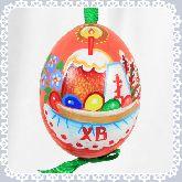 Пасхальное яйцо куриное на ленте Пасхальный стол