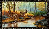Олени у реки в лесу